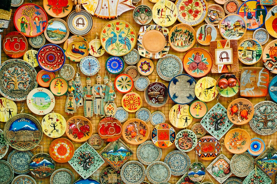 A wall of colourful ceramic plates.