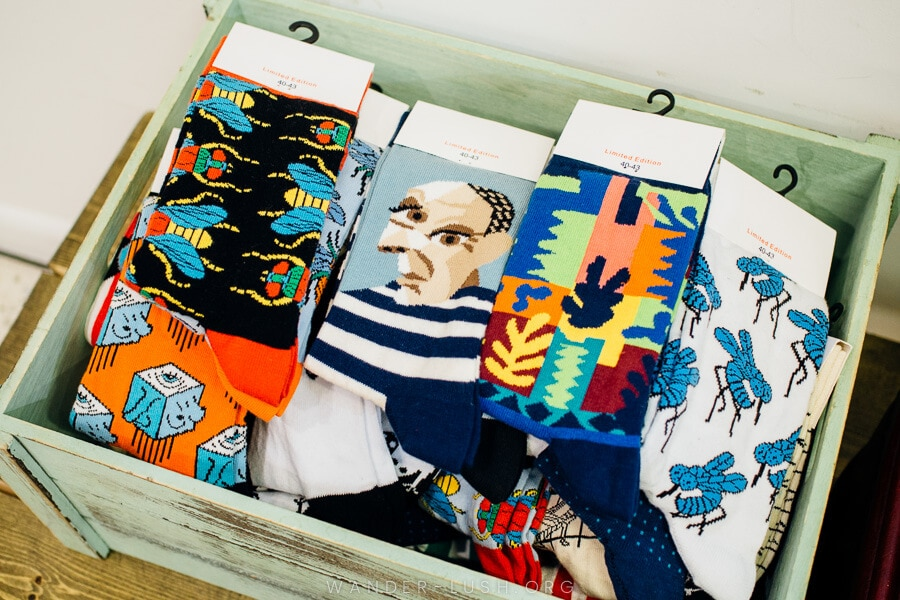 A box of funky socks with modernist art designs.