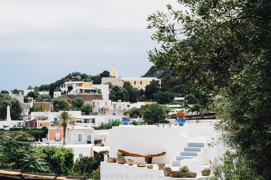 White houses and trees on the Aeolian Islands.