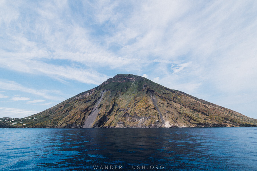 A volcano viewed from the sea.