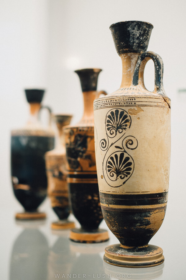 Four ancienct clay vases with beautiful black patterns.