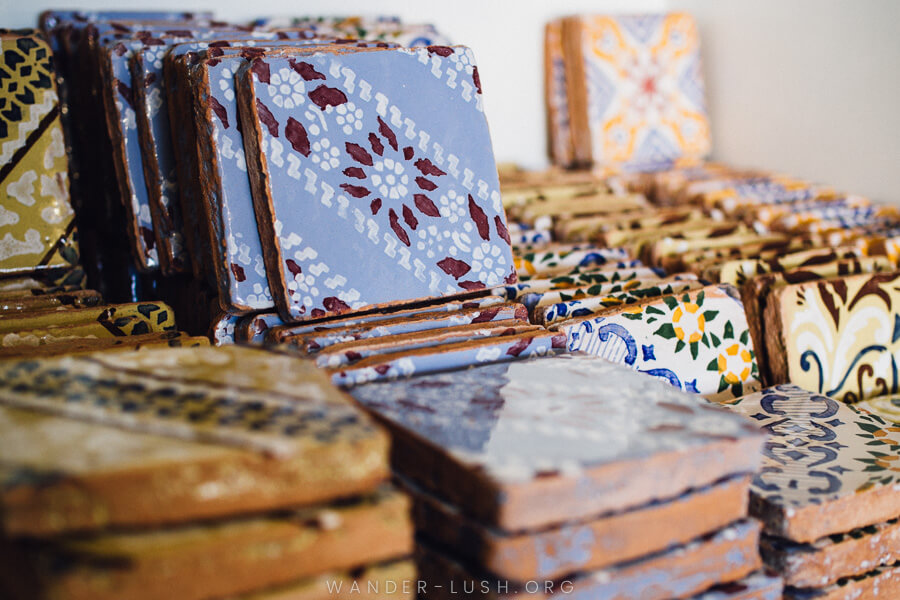 Colourful hand-pressed tiles in a stack.