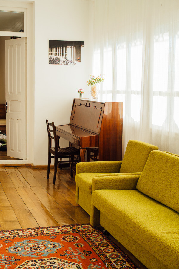 A light-filled room with a bright yellow sofa..