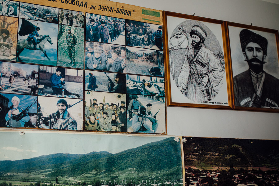 Photos of Chechen men stuck on a wall at the Ethnography Museum in Pankisi Gorge.
